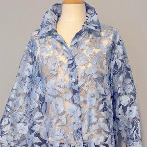 Gently worn woman's Tanjay flowered shirt.